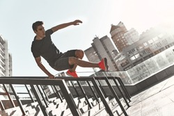 Best cardio ever. Full length of young man in sports clothing jumping while exercising outside
