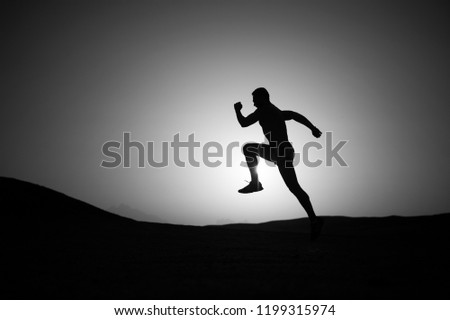 Best cardio. running man on mountain nature landscape on sky background in summer or spring, business and success, energy fitness, gym and health, sport and recreation #1199315974
