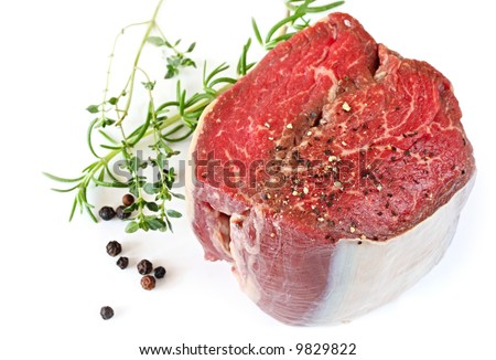 Best cut of beef fillet steak, ready for cooking.  With peppercorns, rosemary and thyme.