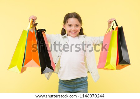 Best discounts and promo codes. Back to school season great time to teach budgeting basics children. Girl carries shopping bags. Prepare for school season buy supplies stationery clothes in advance. #1146070244