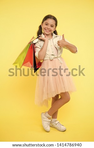 Best discounts and promo codes. Girl carries shopping bags. Back to school season great time to teach budgeting basics children. Prepare for school season buy supplies stationery clothes in advance.