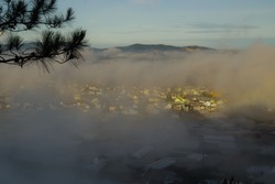 best experience and tourist in Dalat city, Vietnam at southeast asia. Beautiful village appear and disappear in the fog at sunrise with peaceful life, hospitality and relaxing