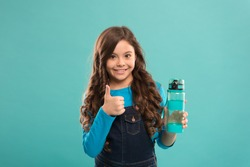 best for your health. small girl hold bottle. detox and people. healthy drink for teen child. Drink water for health care and body balance. thirsty kid drink water. drink water preventing dehydration.