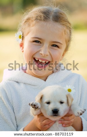 Best friends - happy girl with cute puppy