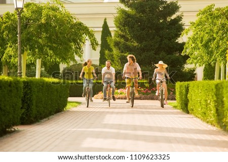 Best friends having fun on bikes. Group of young active students riding bicycles outside. People, leisure and lifestyle. #1109623325