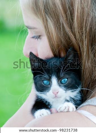 Best friends - lovely teenage girl with cute kitten