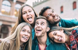 Best friends taking selfie at city tour trip - Happy friendship with millennial people having fun together outdoor - Everyday life concept of new generation representatives enjoying carefree lifestyle