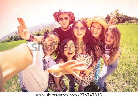 Best friends taking selfie at countryside picnic - Happy friendship concept and fun with young people and new technology trends - Vintage filter look with marsala color tones - Fisheye lens distortion