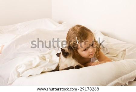 Best friends whispering - little girl with her kitten