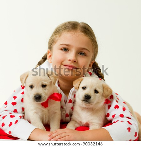 Best friends - young girl with cute labrador puppies