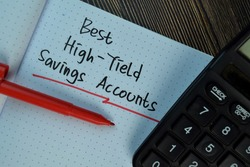 Best High-Yield Saving Accounts write on a book isolated on Wooden Table. Finance Concept