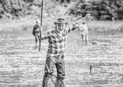 best moment. mature man fishing. summer weekend. fisherman with fishing rod. pothunter. man catching fish. retired bearded fisher. big game fishing. sport activity and hobby. Trout bait.