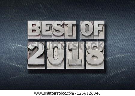 best of 2018 phrase made from metallic letterpress on dark jeans background #1256126848