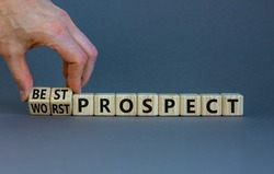Best or worst prospect symbol. Businessman turns wooden cubes and changes words 'worst prospect' to 'best prospect'. Beautiful grey background. Business, best or worst prospect concept. Copy space.