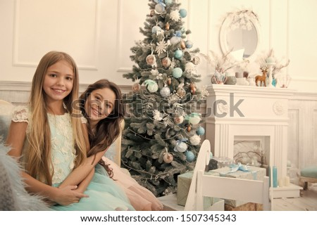 Best present. Child enjoy the holiday. Christmas tree and presents. Happy new year. Winter. xmas online shopping. Family holiday. The morning before Xmas. Little girls.