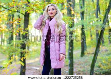 Best puffer coats to buy. How to rock puffer jacket like star. Puffer fashion concept. Outfit prove puffer coat can look stylish. Jackets everyone should have. Girl fashionable blonde walk in park. - Shutterstock ID 1222735258