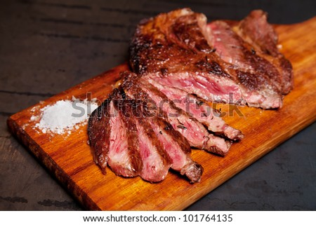 best quality ox meet with fleur de sel   in a wood - stock photo