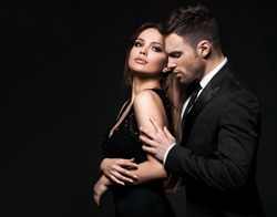 Best sexy elegant couple in the tender passion. Black background.