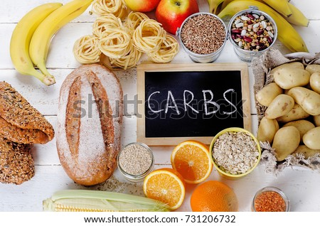 Best Sources of Carbs on a white wooden background. Top view #731206732