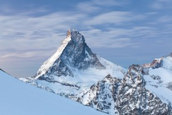 Best Viewing point for the Matterhorn in Zermatt. Amazing views over the snowy Swiss and Italian alps. Beautiful sunny day in christmas time, happy new year celebrated in mountains. Skiing, climbing