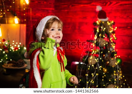 Best wishes for you your family this christmas. Merry christmas and happy new year. Cute boy play near christmas tree. Kid enjoy winter holiday at home. Home filled with joy and love. Make wish.