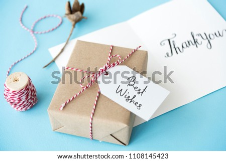 Best Wishes tag on a gift box #1108145423