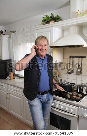 bestager makes a phone call in the kitchen