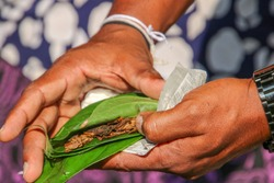 Betel nut leaf and tobacco quid ready for chewing in Sri Lanka