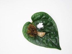 Betel quid or Paan is a combination of betel leaf, areca nut and
