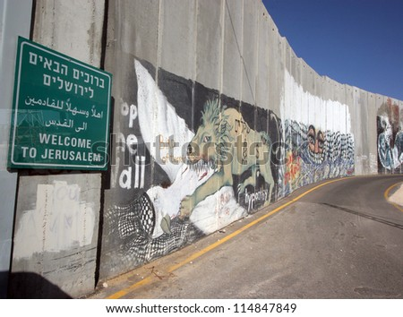BETHLEHEM, OCCUPIED PALESTINIAN TERRITORIES - OCTOBER 05: Activist graffiti adorns the Israeli separation wall in the West Bank town of Bethlehem on October 05, 2006.