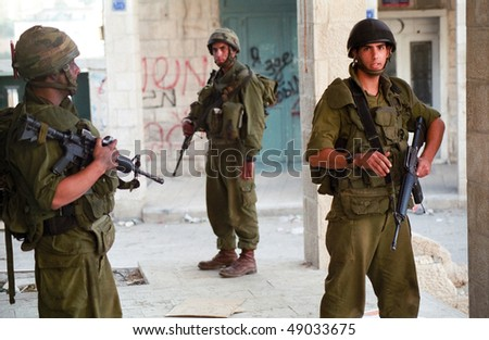 BETHLEHEM, PALESTINIAN AREAS - MAY 28: Soldiers of the Israeli Defense Forces patrol the West Bank town of Bethlehem during a curfew imposed on its Palestinian residents May 28, 2002 in Bethlehem.