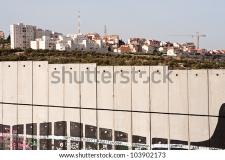 BETHLEHEM, PALESTINIAN TERRITORIES - MARCH 10: Construction continues in the Israeli settlement of Gilo, separated from the West Bank town of Bethlehem by the Israeli separation wall, March 10, 2012.