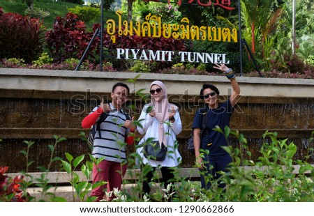 BETONG, THAILAND - JAN 19, 2019: Tourists at the entrance of the popular Piyamit Tunner entrance in Betong, Thailand. #1290662866