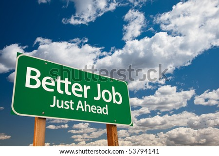 Better Job, Just Ahead Green Road Sign with Copy Room Over The Dramatic Clouds and Sky.
