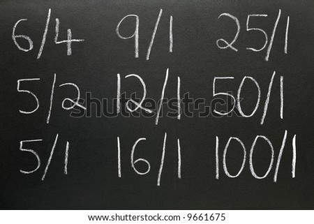 Betting odds written on a blackboard.