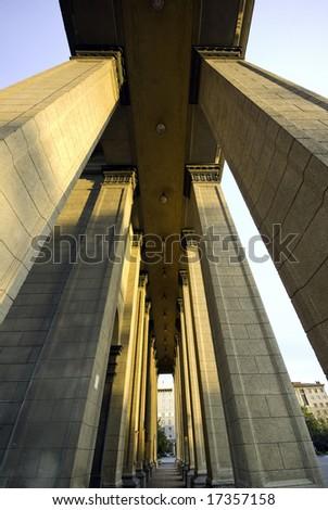 between the columns corridor abstract wide shot