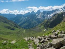 Beutiful green summer alpine mountain valley with winding river spring stream. Stubai hiking trail, Stubai Hohenweg at Tyrol, Austrian Alps