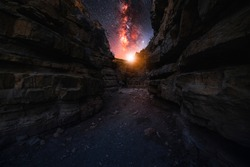Beutiful night landscape. Red canyon at the starry night with bright bright milkyway galaxy.