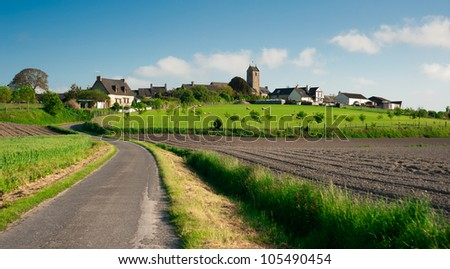 Beutiful typical french village in countryside of Normandy - France