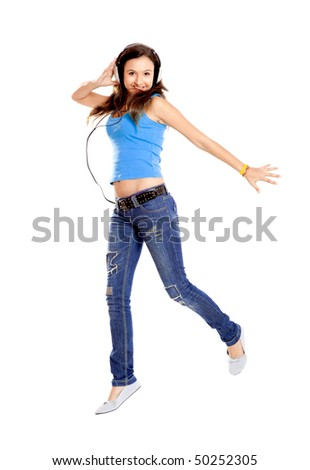 Beutiful young girl dancing and listen music, isolated on white