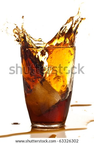 beverage splash into glass on a white background