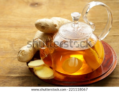 beverage tea with ginger and fresh root on a wooden background
