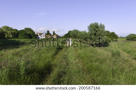 BEVERLEY, UK - JUNE 23: Ramblers use footpath along the bank of the river Hull on a fine summer day on June 23, 2014 near Beverley, Yorkshire, UK.