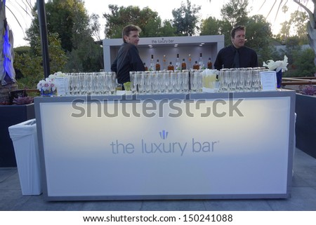 BEVERLY HILLS - AUG 15: Atmosphere at a summer celebration hosted by Delta Air Lines at a private residence on August 15, 2013 in Beverly Hills, California
