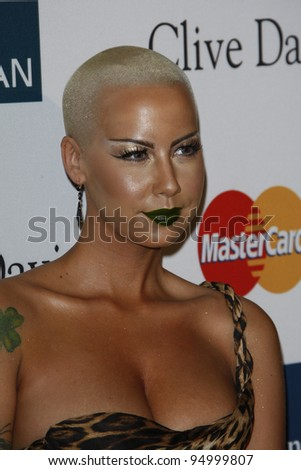 BEVERLY HILLS, CA - FEB 11: Amber Rose at the Clive Davis and the Recording Academy's 2012 Pre-GRAMMY Gala on February 11, 2012 in Beverly Hills, California