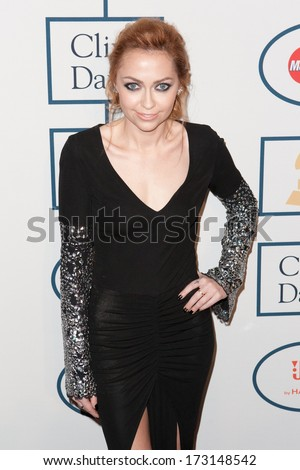 BEVERLY HILLS, CA. - JANUARY 25: Brandi Cyrus arrives at the Clive Davis and The Recording Academy annual Pre-GRAMMY Gala on January 25th 2014 at the Beverly Hilton in Beverly Hills, California.