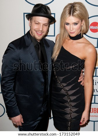 BEVERLY HILLS, CA. - JANUARY 25: Gavin DeGraw & Delta Goodrem arrive at the Clive Davis & The Recording Academy annual Pre-GRAMMY Gala on January 25th 2014 at the Beverly Hilton in Beverly Hills.