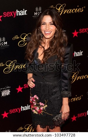 BEVERLY HILLS, CA - MAY 21: Sarah Shahi arrives at the 2012 Gracie Awards Gala on May 21st 2012 at the Beverly Hills Hilton in Beverly Hills.
