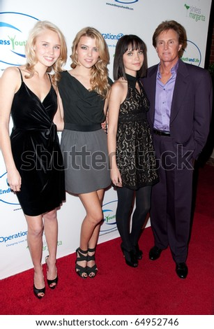 BEVERLY HILLS, CA - NOVEMBER 11: TV Personality Bruce Jenner (R) and local models, arriving to the Endless Youth & Life store opening celebration, on November 11, 2010 in Beverly Hills, CA
