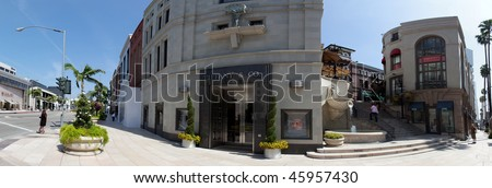 BEVERLY HILLS - CIRCA MAY 2009: Panoramic shot of intersection of Rodeo Drive and Wilshire Blvd. circa May 2009 in Beverly Hills. Rodeo Drive is a top tourist destination in Los Angeles, California.